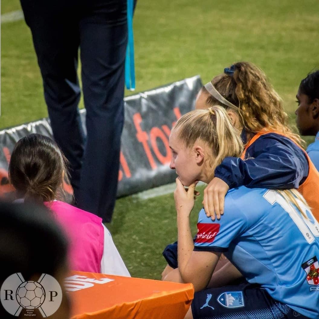 Taylor Ray being comforted by Sydney FC teammate Julia Vignes - Rhianna Payne